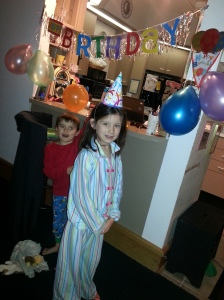 Never too early for balloons and a party hat